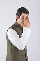 Actor portraying a politician hiding his face