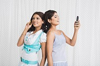 Two women using mobile phones