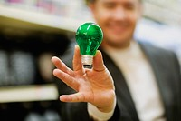 Mid adult man showing a light bulb