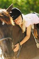 Portrait of a girl horseback riding