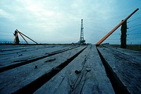 Onshore Oil Drilling Rig with Wooden Bridge in Foreground