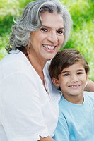Portrait of a senior woman and her grandson smiling