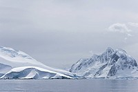 Snow_covered mountains near Petermann Island on the west side of the Antarctic Peninsula.