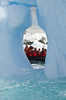 Zodiac and iceberg detail in and around the abandoned British research base W in Crystal Sound near the Antarctic Peninsula during the summer months. ...