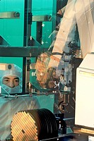 business technology cleanroom worker in plant