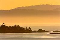 Mountain at oceanside, Strait of Georgia, Victoria, British Columbia, Canada