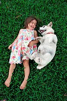 dog girl child person playing in grass 1 animal
