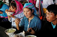 woman eating Pho, national dish, market of Dong Van, Ha Giang province, northern Vietnam, southeast asia