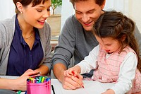 Portrait of a young family, interacting together Could also be used in a Kindergarden/Preschool context