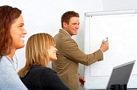 Young businessman giving a presentation to co_workers