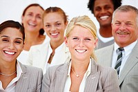 Portrait of happy business people against white background