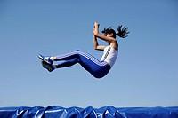 Woman falling on safety mat