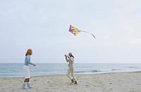 Two female Friends laughing while a Kite flies by _ Friendship _ Fun _ Trip _ Season _ Beach