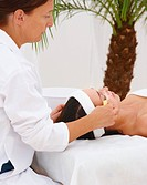 Mature female therapist working at a spa