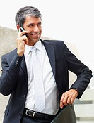 Portrait of a senior business man speaking to someone using a mobile phone