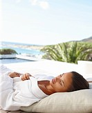 Young female in a bath robe sleeping outdoors