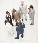 Upward view of a team of business people standing together