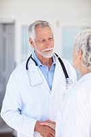 Image of two successful old doctors communicating with each other