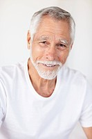Portrait of a handsome old man smiling confidently