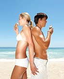 Profile image of a lovely couple having an ice cream at the beach