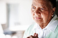 Senior retired woman looking away