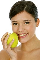 Fitness woman with green fresh apple