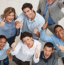 Top view of a happy team of business colleagues gesturing a thumbs up sign