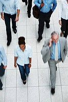 Top view of multi ethnic business executives walking on tiled floor