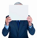 A senior business man holding a blank billboard over his face