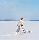 A girl with a kick_sled in the snow, Sweden.