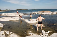 Father and children in the archipelago, Sweden.