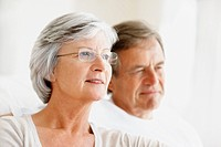Closeup of a relaxed senior couple looking away