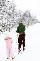Mother and daughter skiing, Sweden.