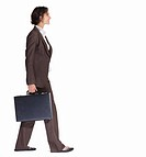 Full length of a business woman with a briefcase walking isolated against white