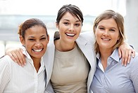 Portriat of pretty smiling business women standing together