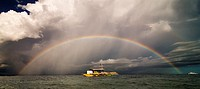 A beautiful full size rainbow on a stormy day in The Philippines.