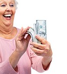 Happy senior woman holding a bunch of currency notes on white background