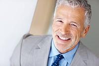 Closeup portrait of a smart mature entrepreneur smiling _ Copyspace
