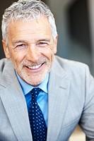 Closeup portrait of a happy senior entrepreneur smiling