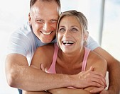 Closeup portrait of a happy mature couple laughing together