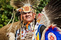 Native American in traditional costume at a powwow in Alberta, Canada