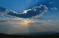 Rays of sunlight from behind a cloud in Steamboat Springs, Colorado, USA.