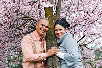 Portland, Oregon, A Couple By A Cherry Tree In Spring