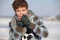 Teenage boy ice_skating and warming up his hands