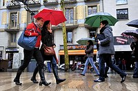 People with umbrellas in a rainy day, La Rambla, Barcelona, Catalonia, Spain