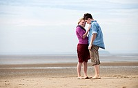 Couple embarrassing on beach