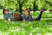 Two boys resting in meadow
