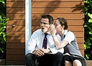 Surprised man hears office gossip