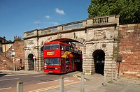 Citysightseeing bus under City wall in Chester Cheshire UK
