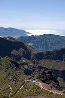 Hikers on Walking Track to Encumeada seen from Pico Ruivo Summit, Pico Ruivo, Madeira, Portugal